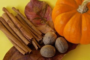 Autumn with pumpkins and cinnamon and nutmeg