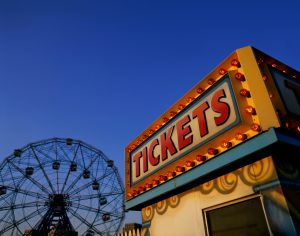 Low angle view of a ticket counter near a ferris wheel, Coney Island, Brooklyn, New York City, New York, USA