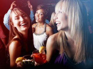 Group of friends having cocktail and enjoying at nightclub