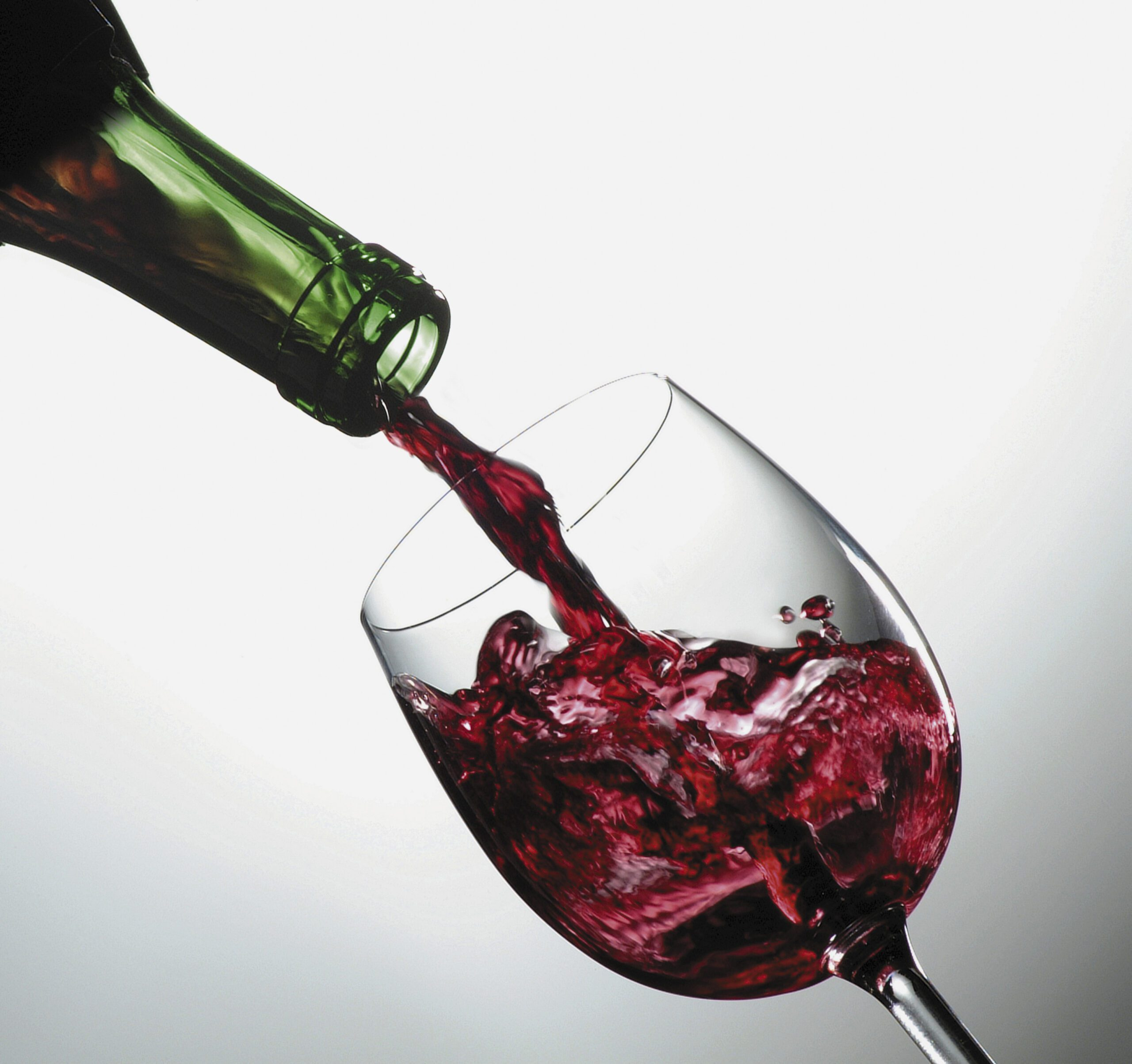Close-up of red wine being poured from a bottle into a glass
