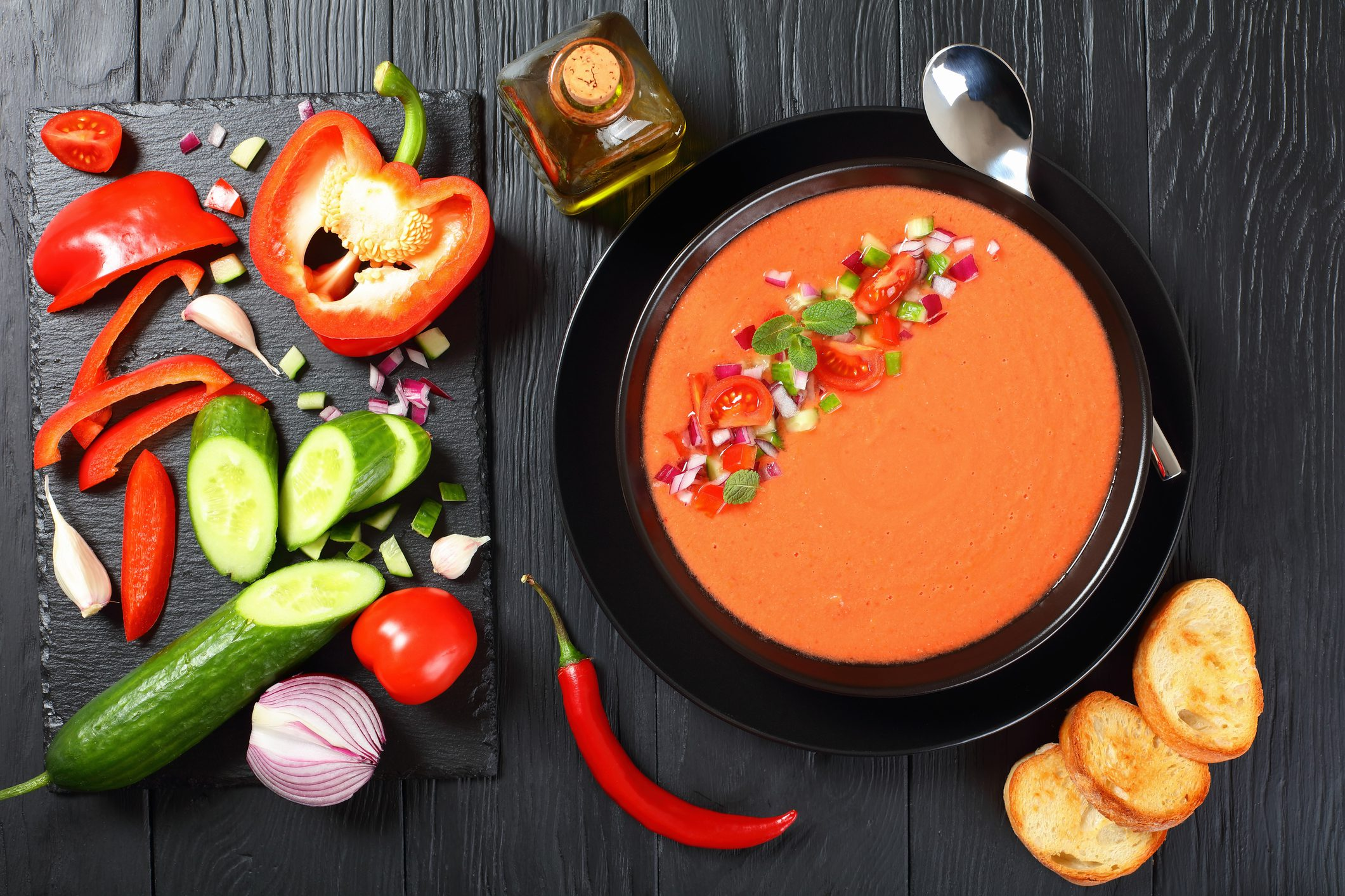 portion of gazpacho in black bowl
