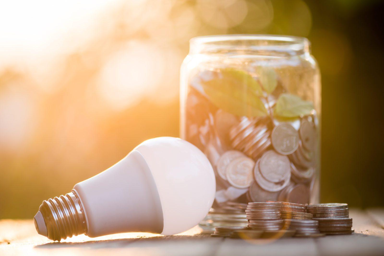 Energy Savings LED Bulb with a jar full of change