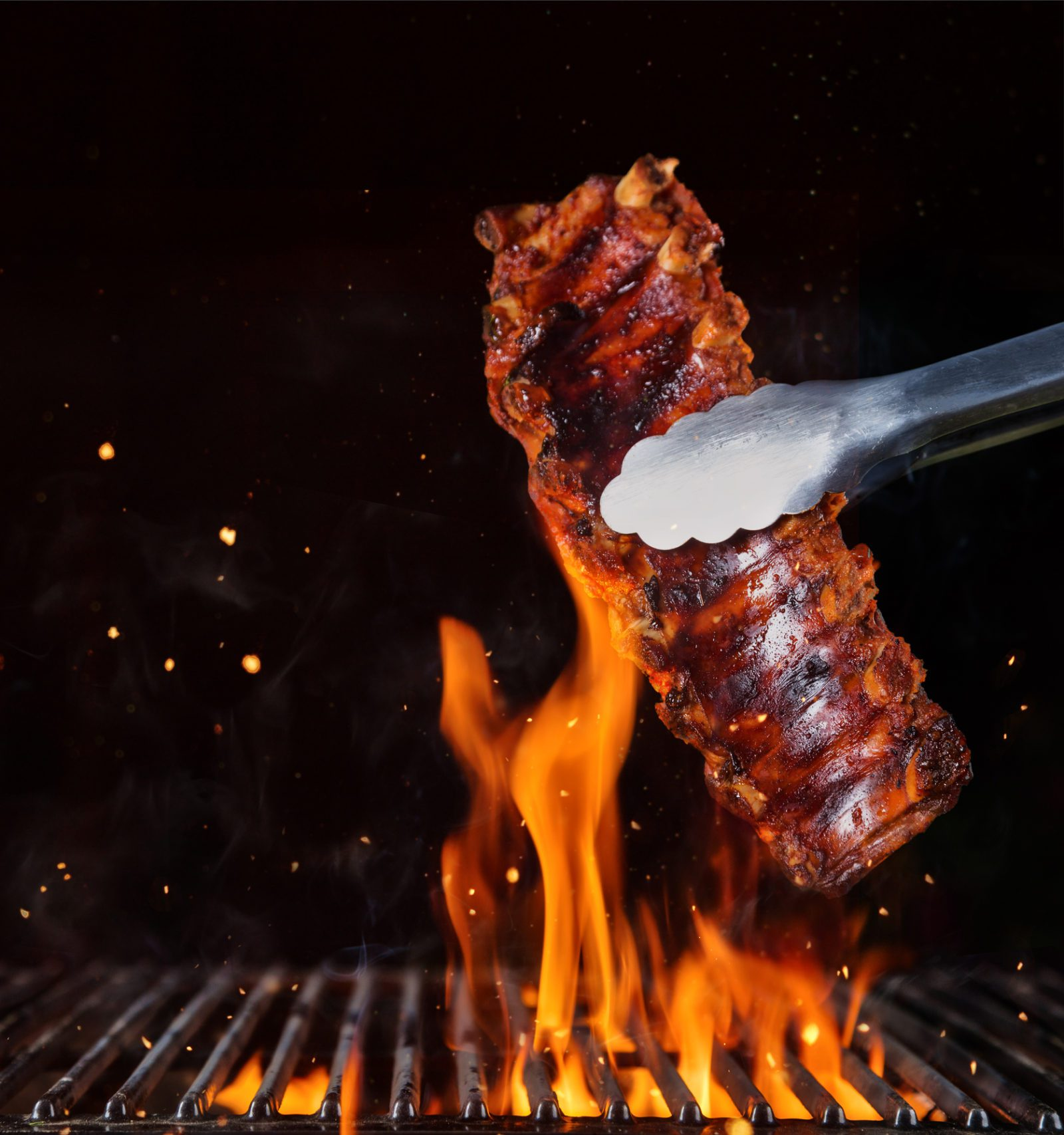 Pork ribs over flaming grill