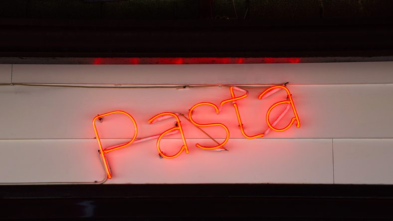 Red bright neon sign with the word Pasta