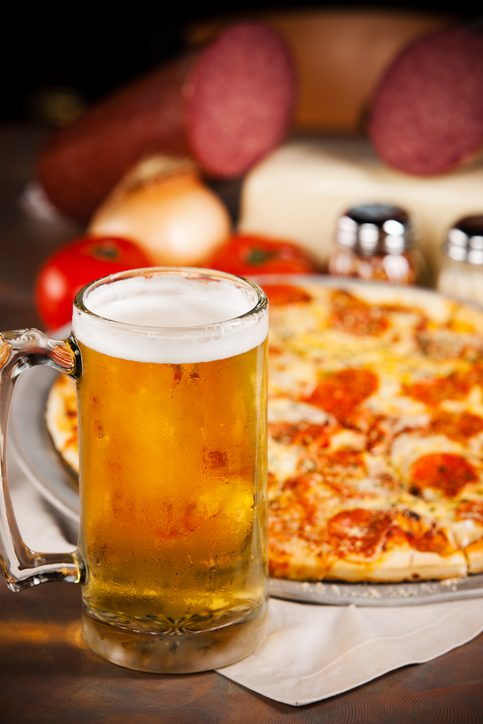 Pepperoni pizza and a frosty mug of cold beer.